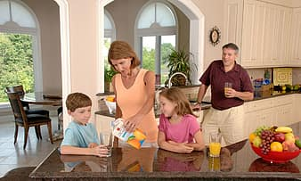 family-drinking-orange-juice-glass-pouring-healthy-home-son-daughter-children-father-thumbnail